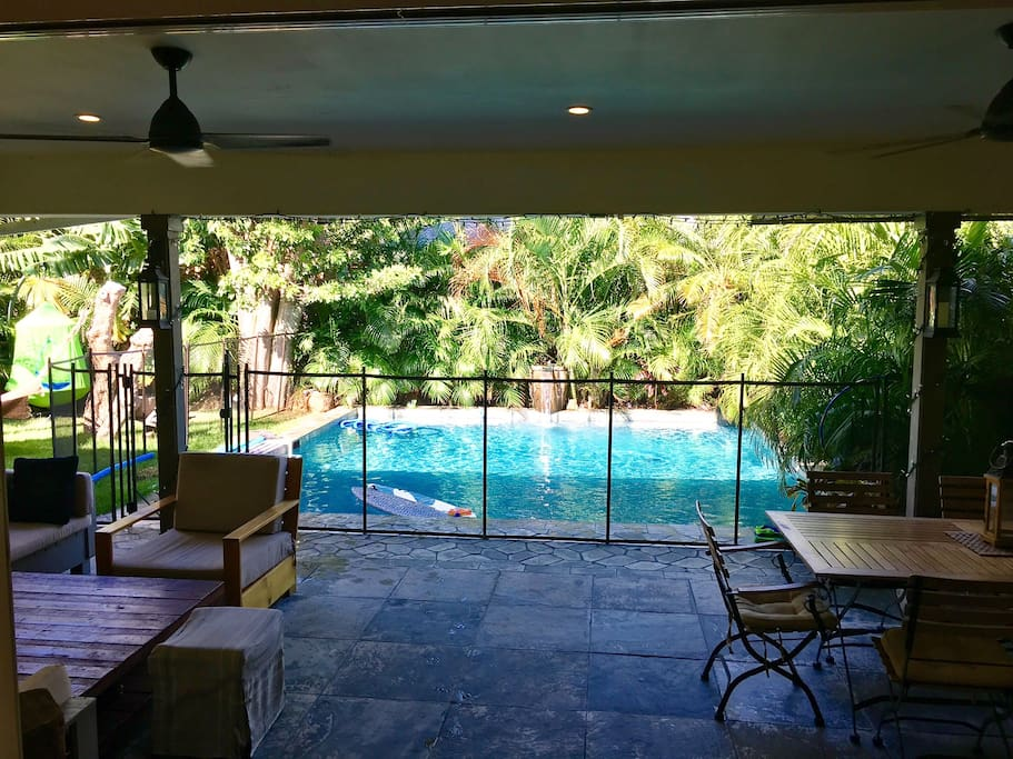 Fenced all around salt water, heated swimming pool with a self closing gate