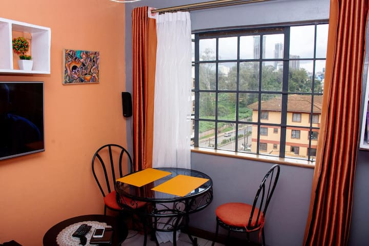 This is the dinning area which overlooks the famous Kipande road which joined the Nairobi Central Business district to Parklands and Westlands. This area can also be used as a work station for business travellers