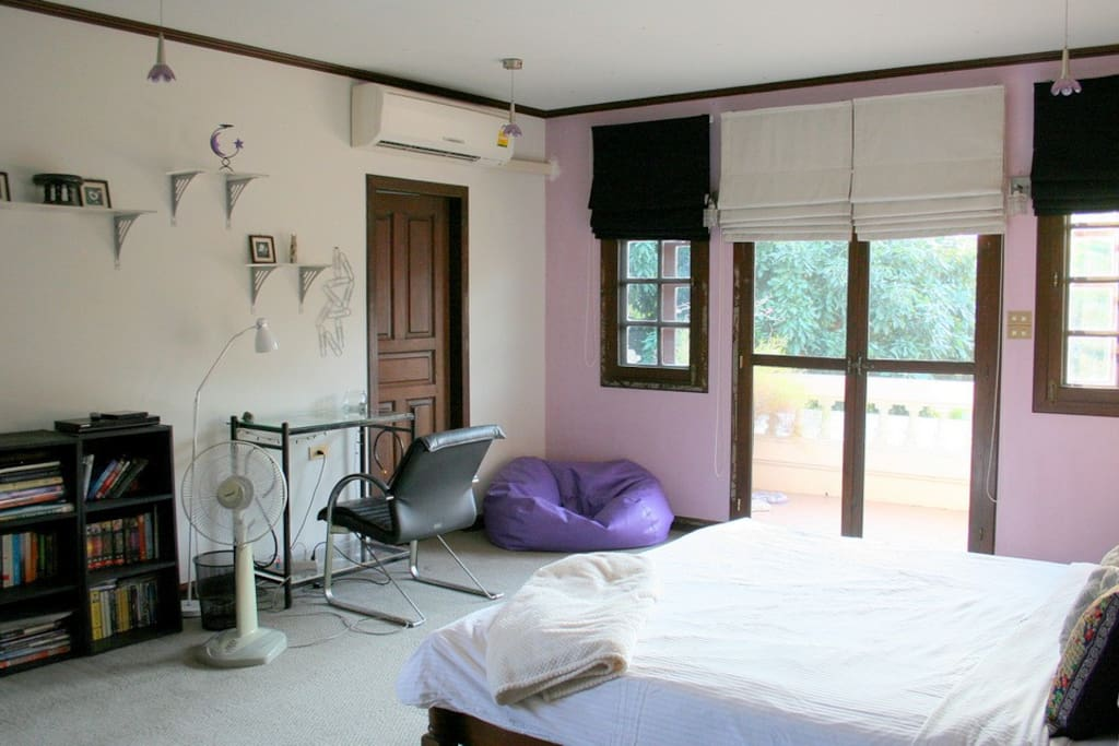 Large airy room with king size bed, desk and lots of closets.