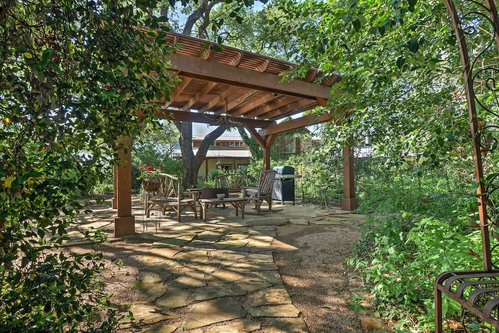 Relax underneath the shade of the pergola with a gas grill and fire pit!