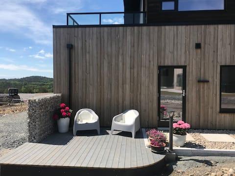 Ny moderne leilighet med sjøutsikt.