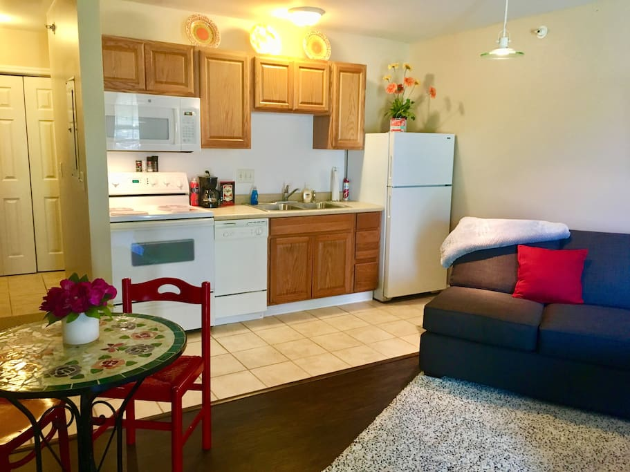 Full kitchen with stove, dishwasher, microwave and full-size refrigerator.  Enjoy the coffee or water on us!