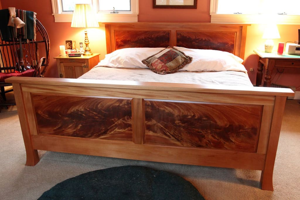 The master bedroom includes a custom king size mahogany bed.