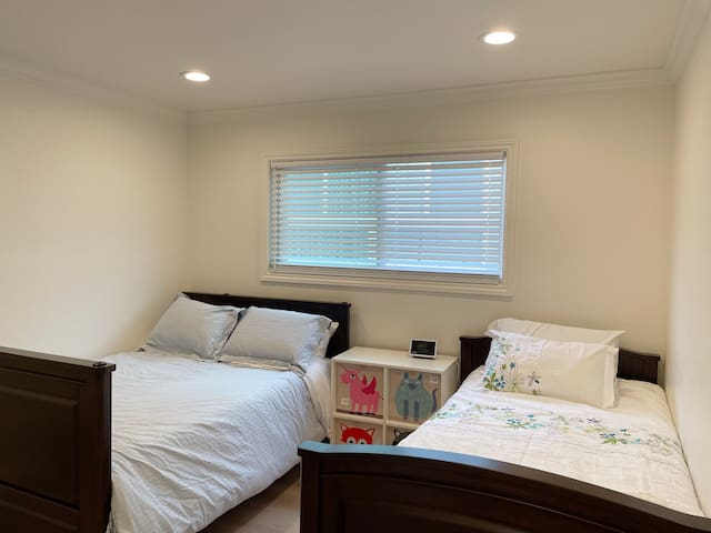 The bedroom 2 has two beds, one full size and one twin size. It also is equipped with google home display and closet for your convenience.