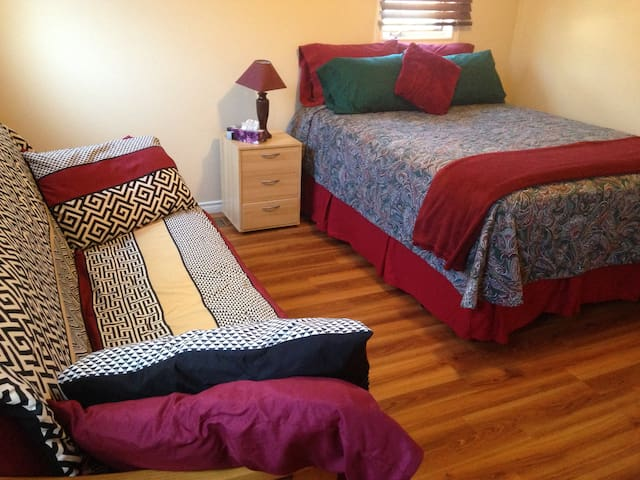 Room 1 includes a queen size bed, a futon and a desk