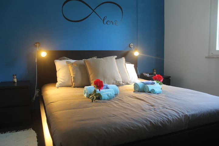 Main bedroom with beds made upon arrival