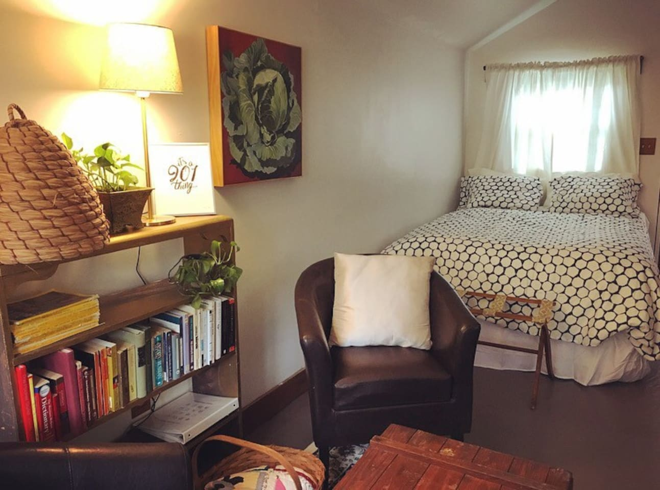 The cottage is a studio apartment with a reading nook and a cozy feather bed.