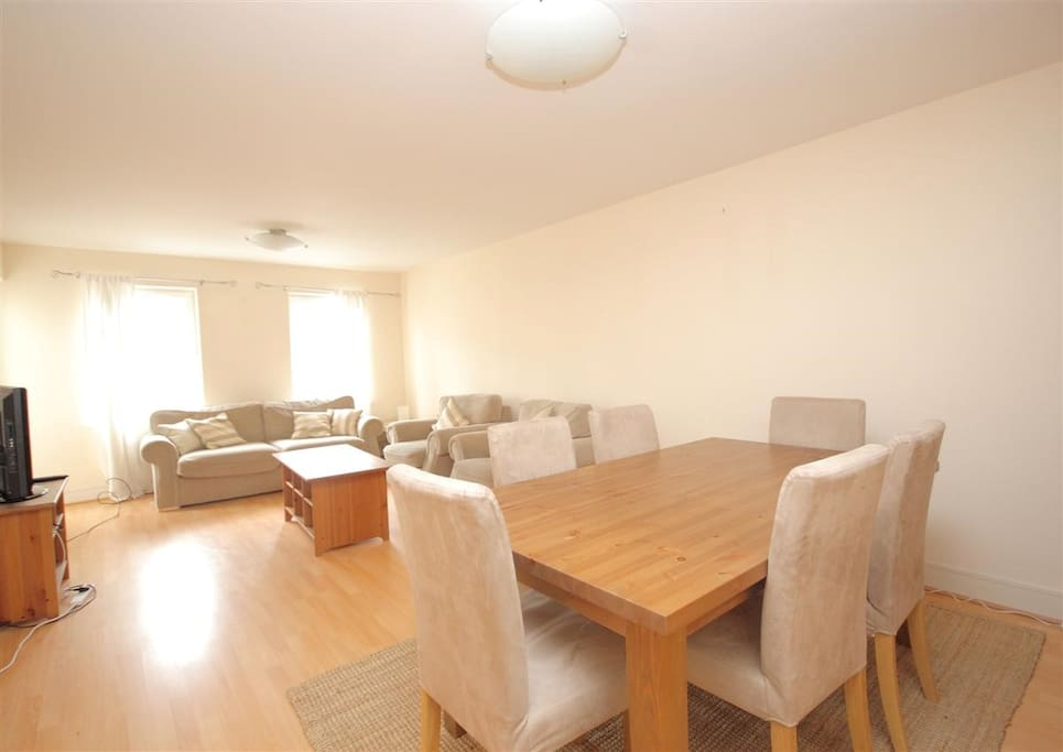 Comfy sofa and chairs as well as dining space for up to six