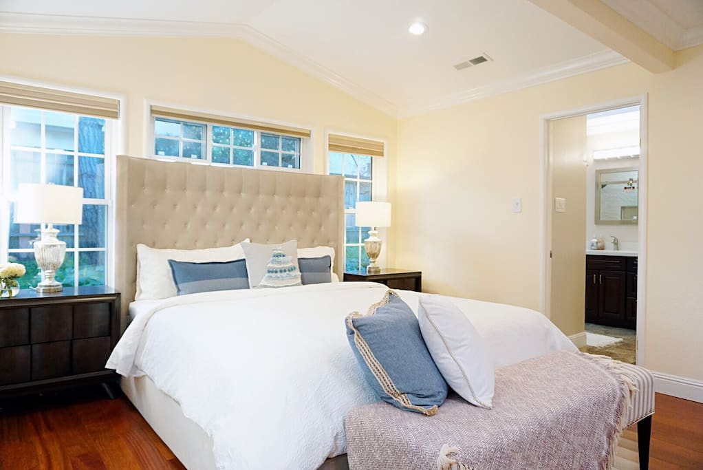 The room with many windows is very bright at daytime. The bench in front of the bed has some pillows and throw blanket as well. Just enjoy!