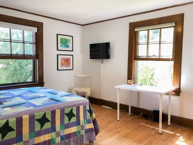 1st floor guest bedroom with desk