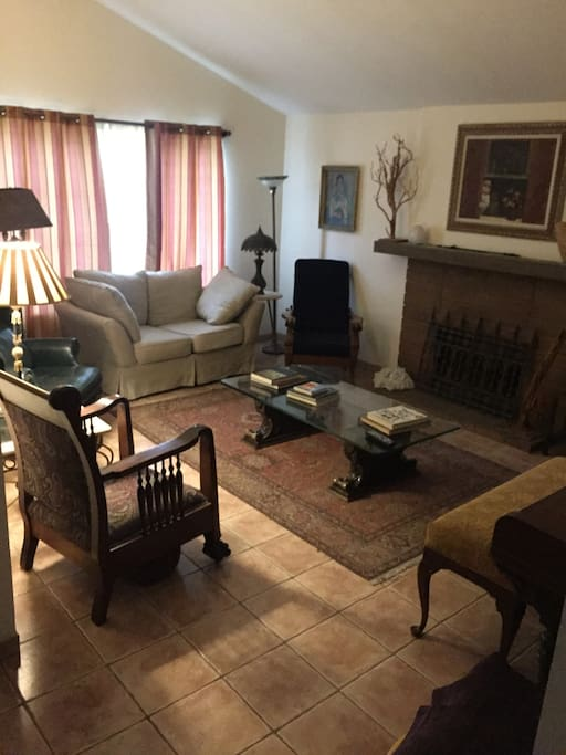 Upon entering, an upright piano and vintage television greet you in the living room for your entertainment, as well as a charming fireplace.