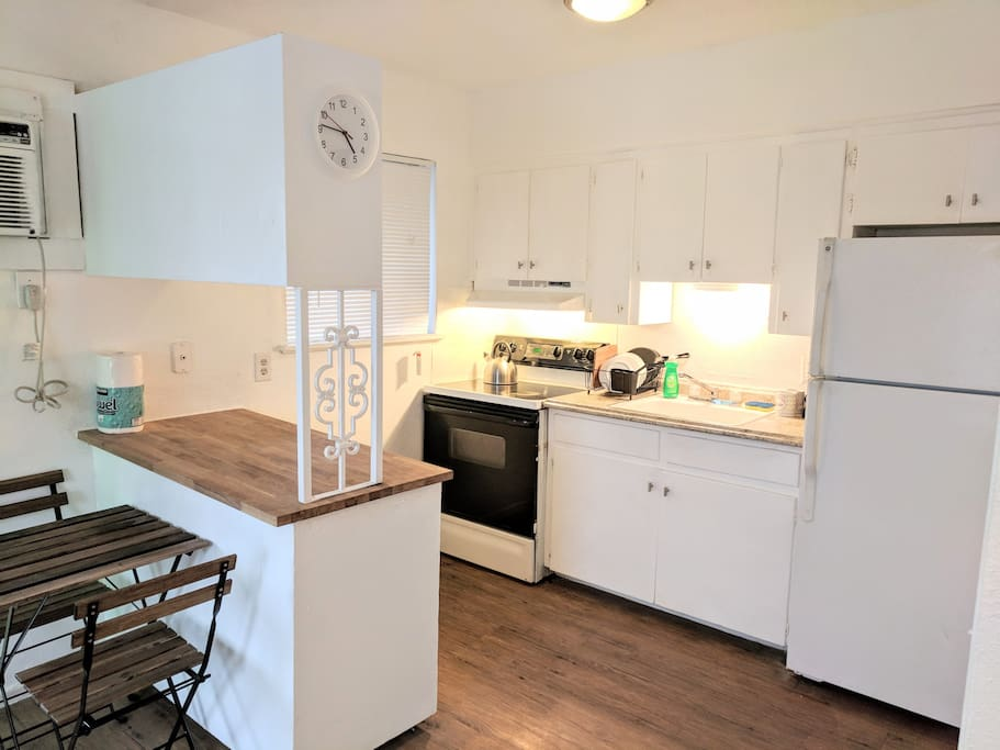 Kitchen with stove, fridge, microwave, coffee maker and coffee provided!