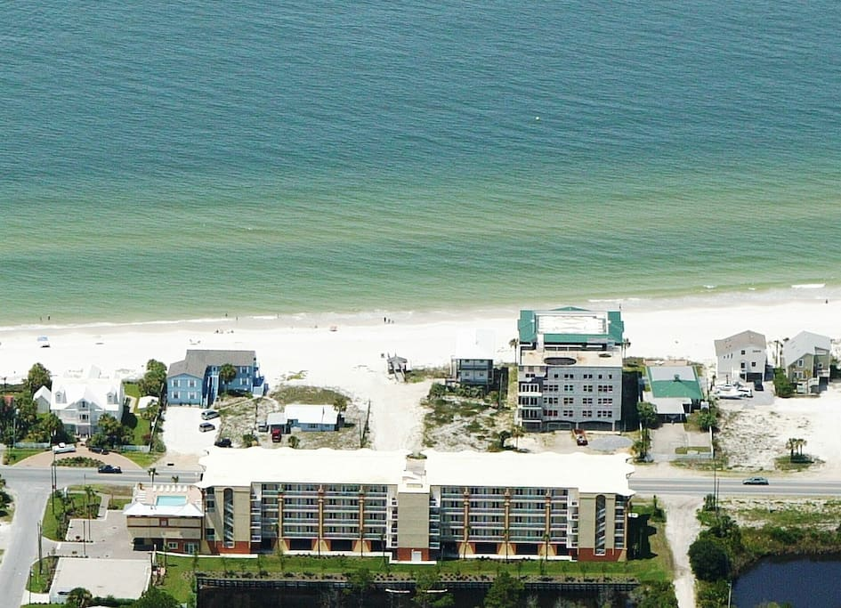 The building is located just across the street from the beautiful beach