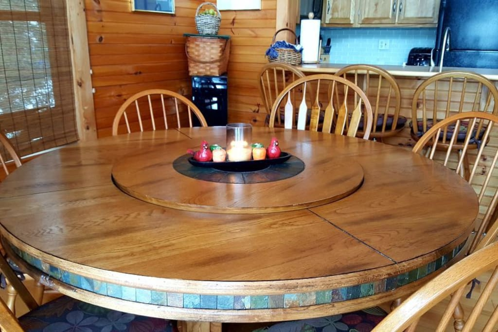 Large slate and hardwood dining table can accommodate 8 .