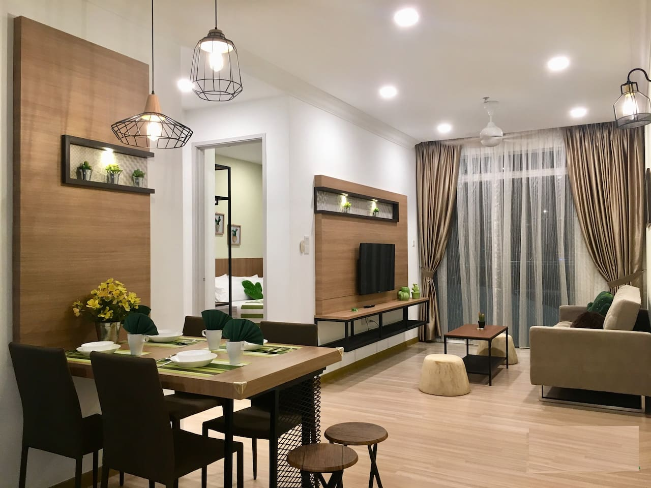 Newly renovated unit, with cafe style setup dining area and woody feel decorated living room