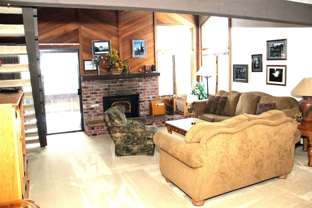 Mammoth Condo Rental Wildflower 18 - Living Room with Woodstove and Outside Deck