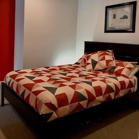 Spacious master bedroom with comfortable queen size bed and ample cupboard space.