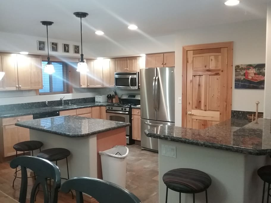 Upgraded stainless steel appliances in remodeled kitchen.
