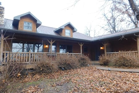 Log home with hot tub, game room