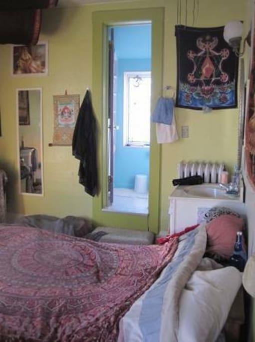 Bedroom with door into bathroom-