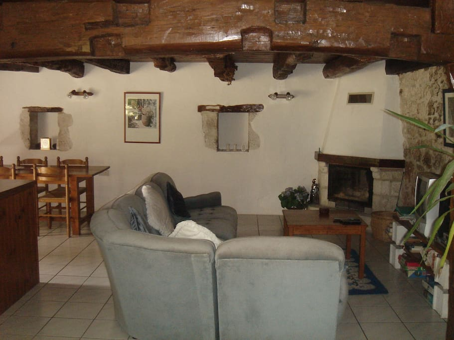 Living area of Couchant with woodburning fire for spring and autumn