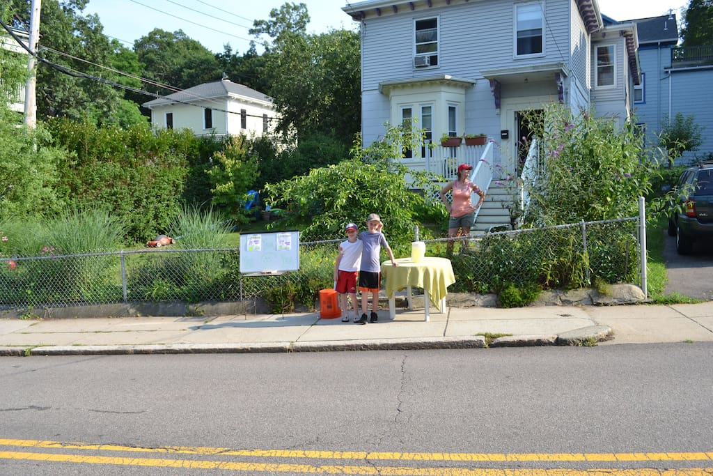 Our 1868 Victorian on lemon-ade stand day! It's a sunny and green corner lot in the heart of Boston
