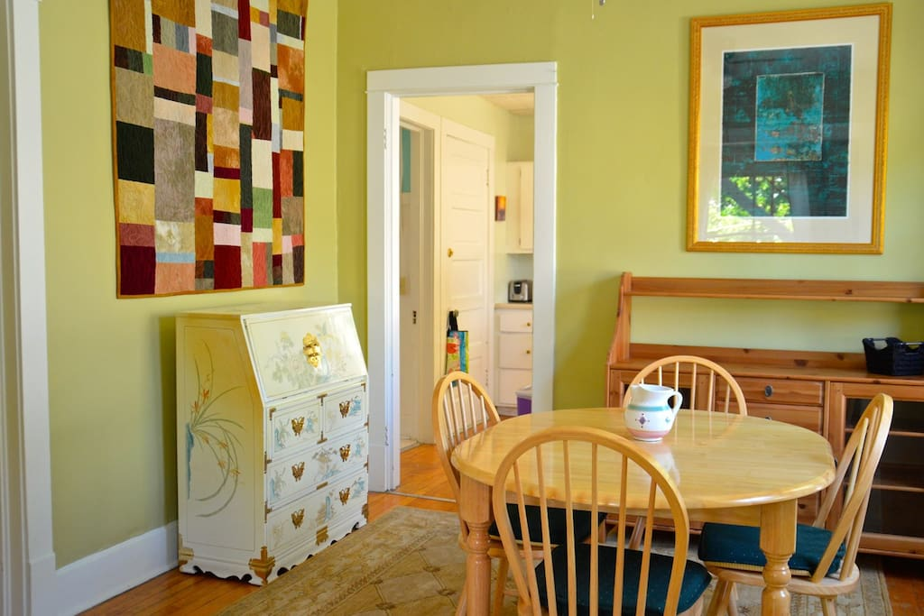 Dining Room is bright and sunny with Hardwood floors, as is the front room.