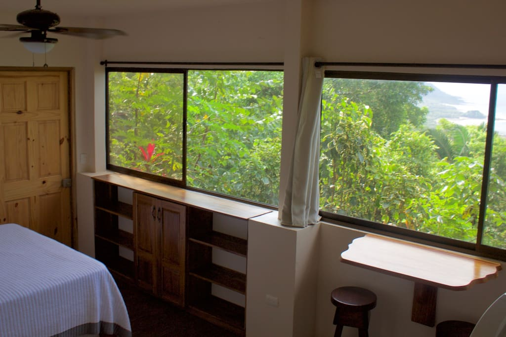 View from the studio along with the breakfast bar, cabinet/shelves and bed. Wake up to the view!
