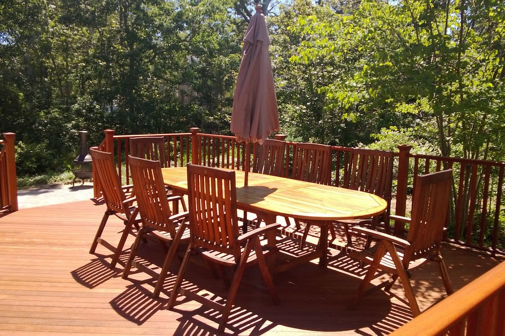 Large new deck with teak furniture