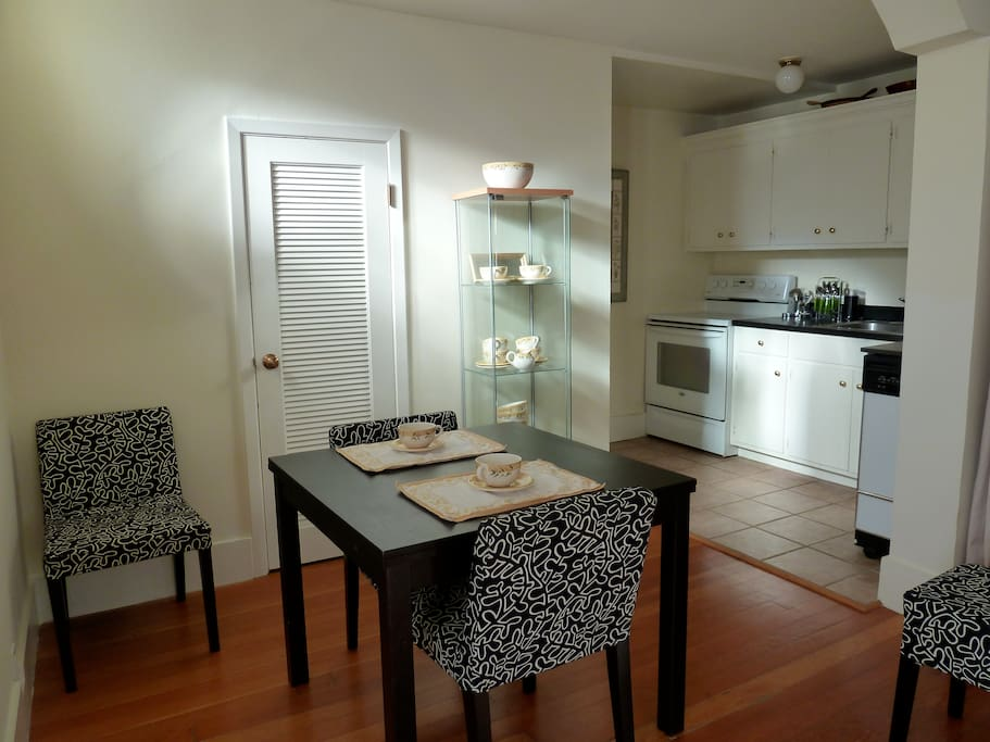 Enjoy cooking and dining in!  Table has extension leaf. Large closet - one of two - with ironing board and iron, in background.