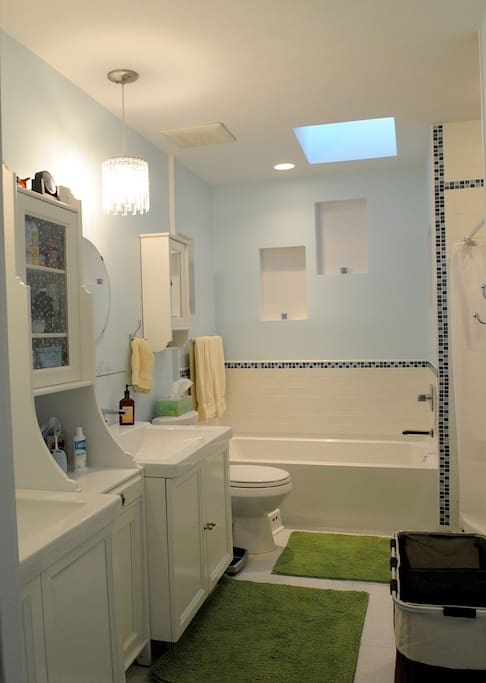 Room for two in this lovely bathroom with double basins, shower, and tub.