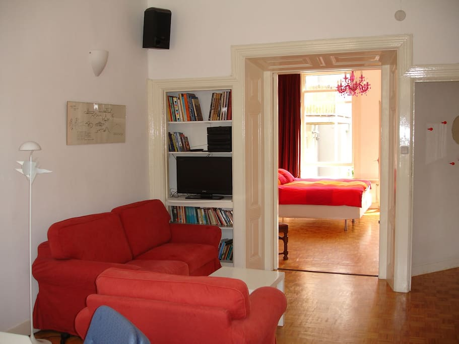 A sliding door can seperate the sleeping room from the living room, with the double sofa-bed.