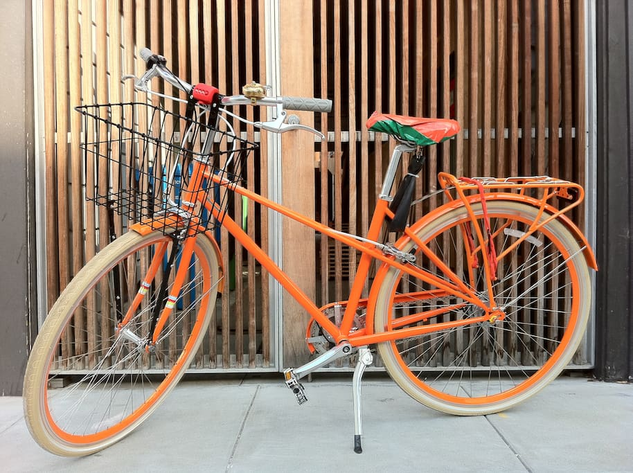 Orange PUBLIC bicycle is available for guests to borrow.