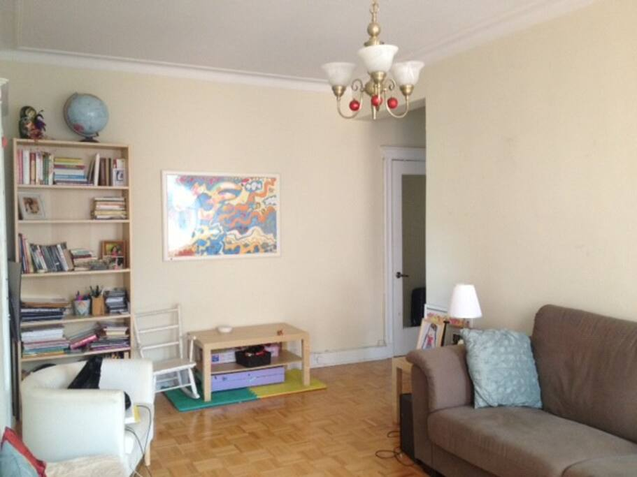 The spacious, sunny living room gets lots of bright light!