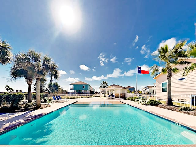 Soak up the sun or relax in the shade of palm trees at the complex pool.