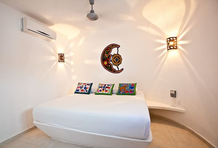 The Sugar Bungalow's 1st bedroom at Cozumel Suites&Apartments Rentals