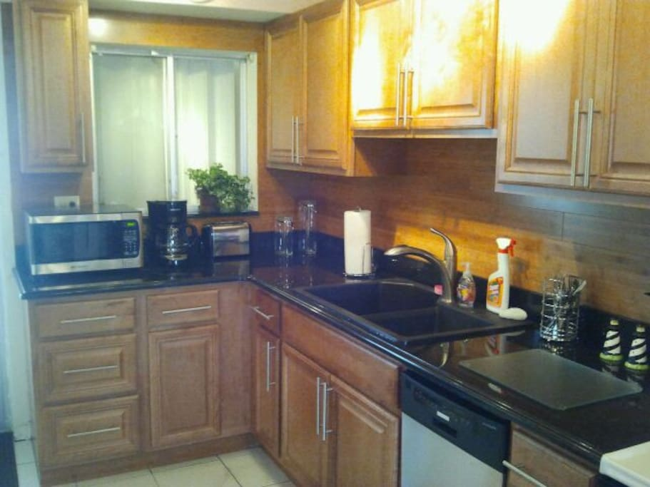 Full kitchen with dishwasher, microwave, coffee maker, toaster