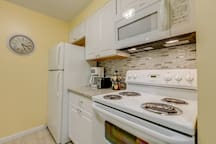 Find everything you need in the kitchen of this home, including all of the appliances necessary to make a home-cooked meal.