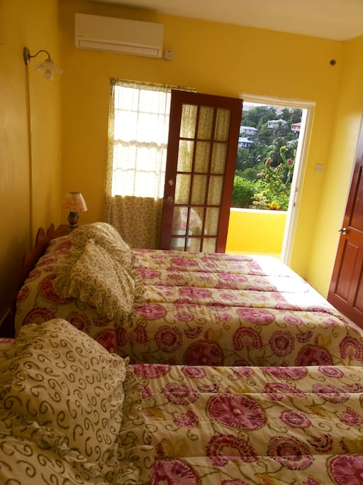 Bedroom with outside view with balcony overlooking view of sea