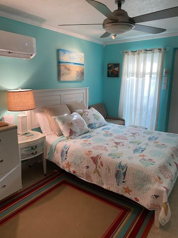 Comfy bed facing TV with access to 2100 world-wide channels & movies!