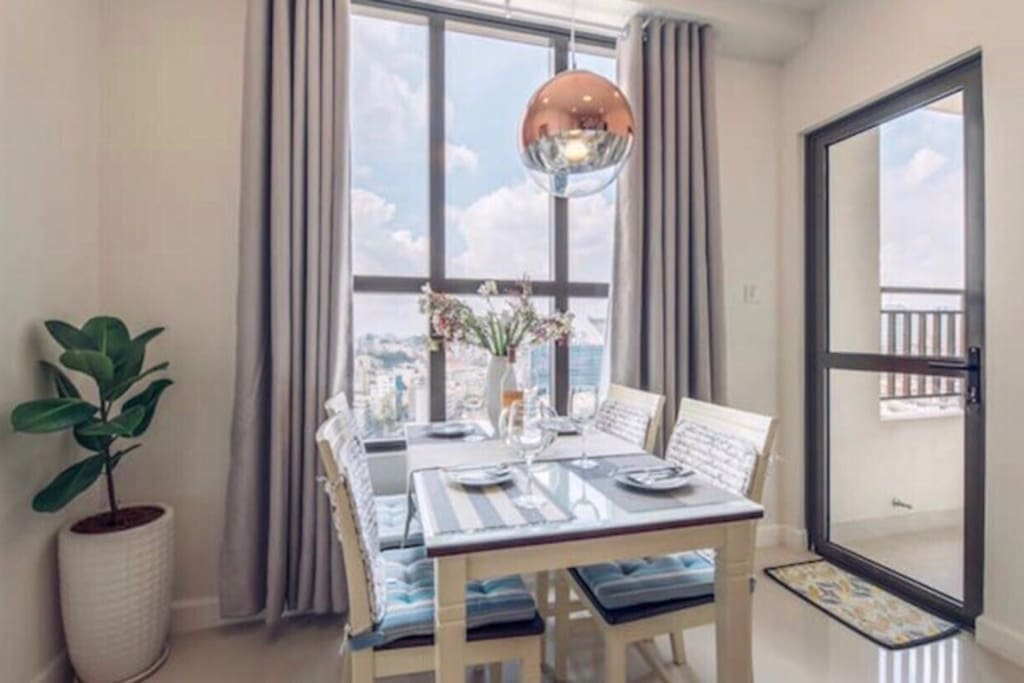 DINING TABLE BY THE WINDOWS