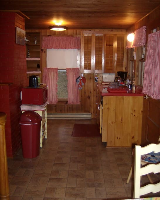 Kitchen - sink on right, stove on left (unseen)