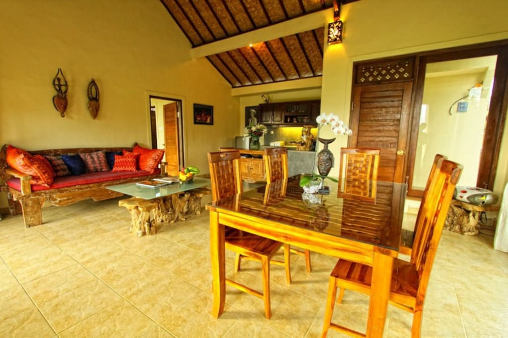 Spacious living room furnished with high quality Teak and antique wood.