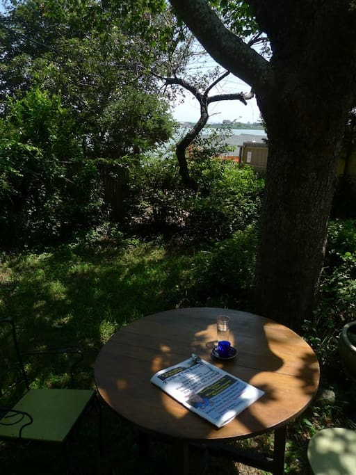 coffee table with view of pond and ocean in distance