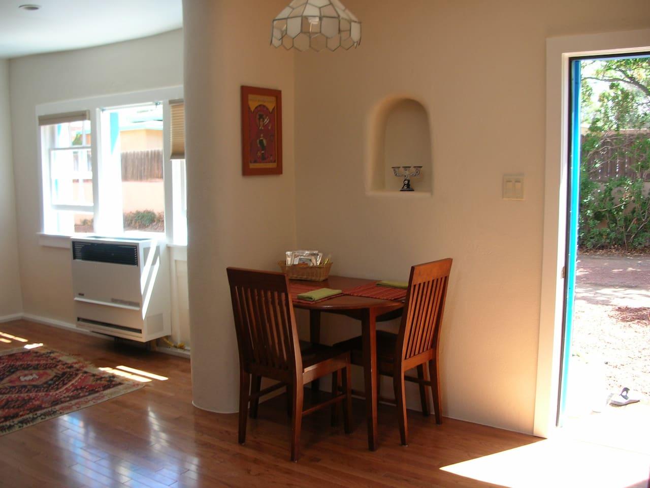 sunny dining area with Santa Fe style nicho