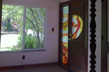 Original Stained Glass door and sidelight in entry mudroom.
