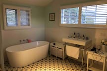 Luxurious bathroom with Sukin products provided