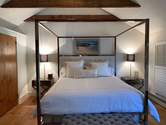 Luxurious Master Bedroom with custom four poster King bed. Vaulted ceiling and 3 large windows with plantation shutters.  10' of closet space. Ceiling fan as well as air conditioning.