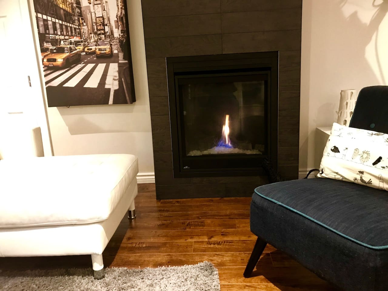 Cosy fireplace in large living room area