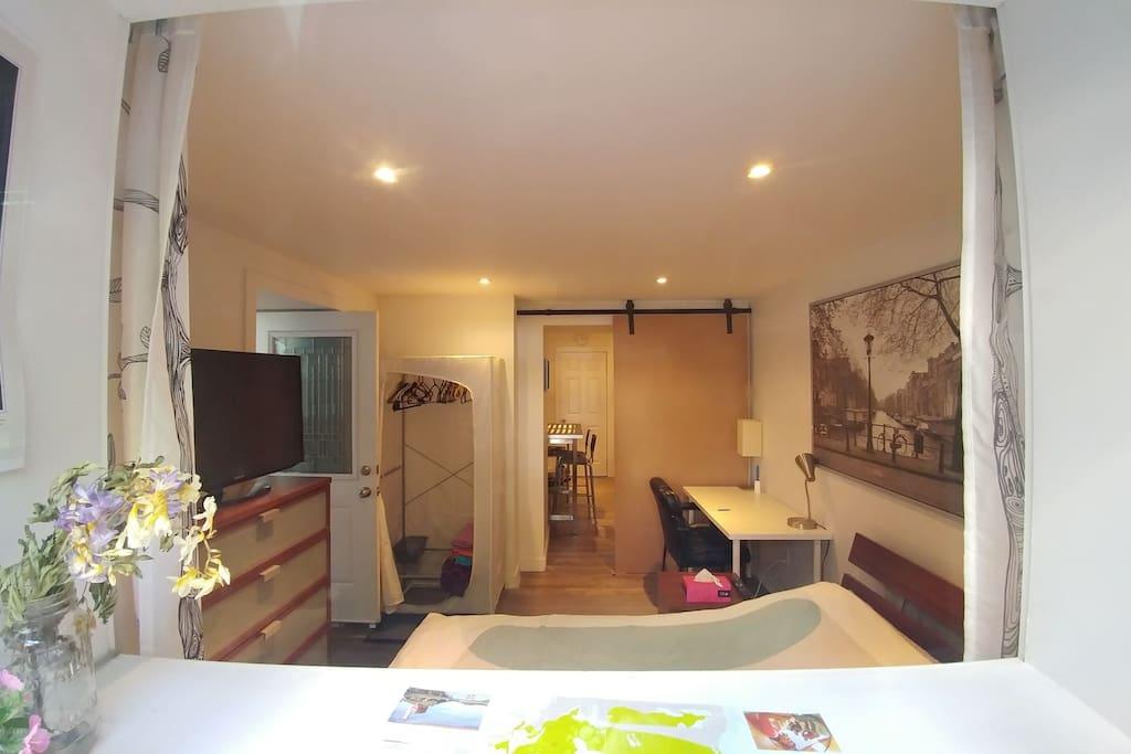 Bedroom 2 with queen bed, desk, ample room and sliding door